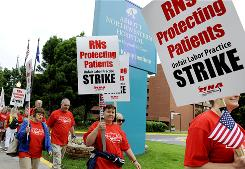 Nurses from several hospitals picketed outside Abbott Northwestern Hospital on June 10, 2010 in Minneapolis as more than 12,000 nurses staged a one-day strike of 14 hospitals in the Twin Cities metro area.