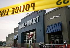 Police on Nov. 28, 2008, examine a Wal-Mart store in Valley Stream, N.Y., where a temporary worker died amid a throng of unruly Black Friday shoppers.