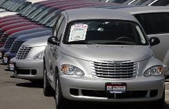 Rows of unsold 2007 Chrysler PT Cruisers sit on the lot of a Chrysler-Jeep agency in the Denver suburb of Aurora, Colo., on Sunday, July 22, 2007.
