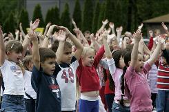 Students at the Valley View Elementary School in Montville, N.J., spell out YMCA during a a program at the school in May 2009.