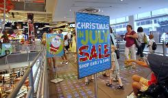"A ""Christmas in July Sale"" signs greet customers, Monday, July 19, 2010, at a Toys R Us store in New York."