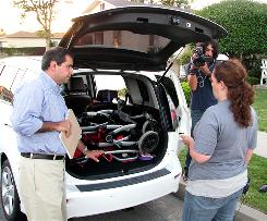 Melissa Zaucha is interviewed by a General Motors crew about her vehicle preferences.