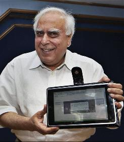 India's Human Resource Development Minister Kapil Sibal displays a low-cost tablet at its launch in New Delhi.