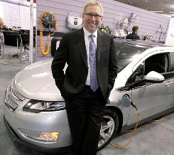 GM U.S. Marketing Vice President Joel Ewanick with the 2011 electric Volt.