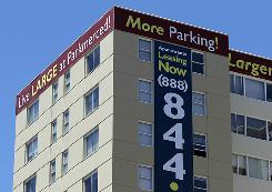 A lease sign is posted on one of the towers at the Parkmerced apartment complex in San Francisco, Cali.