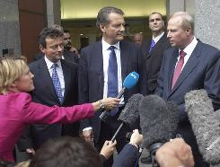 Tony Hayward, BP's outgoing chief executive, left, Carl-Henric Svanberg, chairman, center, and Robert Dudley, incoming CEO, speak with journalists Tuesday at the company's headquarters in London.