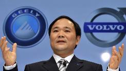 Geely Holding Group Chairman Li Shufu speaks during a news conference in March after a signing ceremony to buy Volvo from Ford.