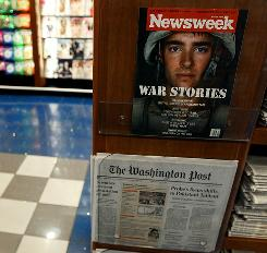 A copy of Newsweek magazine and a copy of the Washington Post are on sale at a news stand on May 5, 2010 in Washington, D.C.