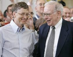 Microsoft co-founder Bill Gates, left, and billionaire investor Warren Buffett are seen during the annual Berkshire Hathaway shareholders meeting in Omaha, on May 6, 2007. Gates and Buffett are launching a campaign to get other American billionaires to give at least half their wealth to charity.