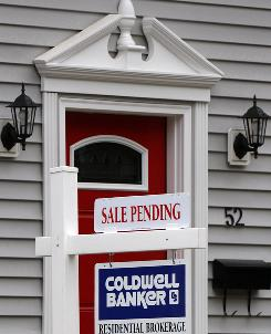 In this July 13, 2010 photo, a sign announces a residential home sale is pending in the Boston suburb of Marborough, Mass. Real estate agents say business grew in July.