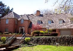 This two-story home built in 1937, surrounded by gardens, is for sale in Topeka for $799,000.