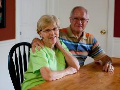 Margaret Allen, with husband Paul in their home in Mesquite, Texas, lost her job about three years ago but was quickly hired to handle billing at the Women's Health Alliance in Dallas.
