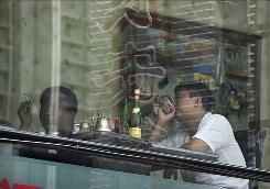 People smoke cigarettes inside a restaurant in Beijing.