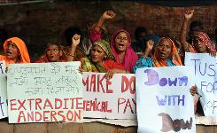 Bhopal gas leak victims shout slogans as they stage a protest near parliament house in New Delhi in July.