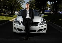 John Krafcik, CEO of Hyundai Motor America, stands in front of the company's newest luxury car, the full-size Equus.