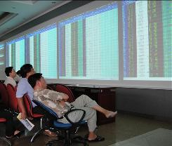 Vietnamese investors monitor stock prices at a local brokerage house.
