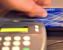 A credit card is swiped at a bank on Aug. 20, 2010.