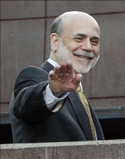 Federal Reserve Chairman Ben Bernanke waves from the veranda of the Jackson Lake Lodge at the start of the annual Federal Reserve conference in Jackson, Wyo.