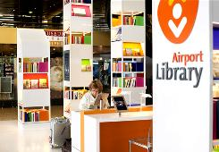 Amsterdam Schiphol Airport has opened a library aimed at travelers on intercontinental flights awaiting their connections. Users can browse through books and a display of national art and download digital audio and video files. The 24-hour facility also features seats with iPads and 14 lounge chairs. 