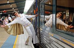 Elvis Presley tribute artist (they don't like to be called impersonators) Paul Hill waves as he boards the 'Elvis Express' at Central Station in Sydney on Jan. 8, 2010, for the 18th annual Elvis Festival in Parkes.