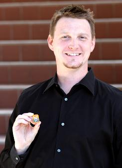 CEO Jef Holove holds a tiny but powerful Eye-Fi wireless memory card.