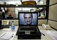 Odysseas Tsatalos, co-founder of oDesk, is seen on his computer screen in his office in Menlo Park, Calif.