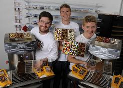 The co-founders and managing partners of Chocomize (from left to right: Erick Heinbockel, 24, of Moorestown, N.J.; Nick LaCava, 23, of Princeton, N.J.; and Fabian Kaempfer, 24, of Nuremberg, Germany) experienced growing pains at their chocolate business after being featured in a magazine article.