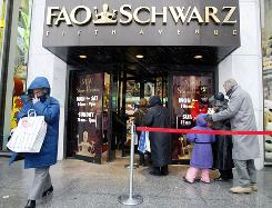 Customers wait in line to enter the flagship FAO Schwarz in New York City. Toys R US plans to open several pop-up stores during the holidays.