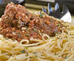 Gluten-free products are filling market shelves and despite the very low percentage of people that have a problem with gluten are making their way to many home pantries. If a dinner free of gluten is needed at your table this meal of spaghetti and meatballs with garlic crumbs fits the bill.