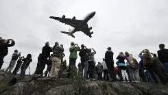 People watch a Lufthansa Airbus A380 at the Helsinki-Vantaa Airport Wednesday.