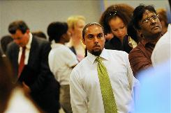 Job seekers wait in line to talk with representatives from an employment agency at a job fair in Los Angeles on Sept. 20.
