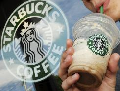 Starbucks says it will raise prices on certain drinks due to rising raw coffee prices.
