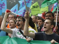 Protesters shout slogans during a march Thursday in Paris to protest President Nicolas Sarkozy's plan to raise the retirement age to 62.