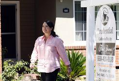 Prudential Realty agent Debbie Wong tours a home she sold recently in Burlingame, Calif.