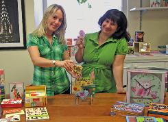 Jennifer Schroder (left) and Lisa Ann Frison say their employer Galison, a maker of stationery and educational games, has already had success with foreign sales.