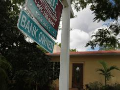 A Bank Owned sign is seen in front of a foreclosed home on Sept. 16, 2010 in Miami.