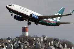 An AirTran jet leaves Logan International Airport in Boston in this file photo.