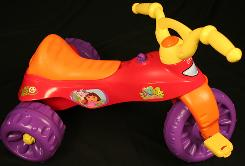 Fisher-Price is recalling this tricycle because children have been injured by the purple 'ignition key' in front of the seat. 