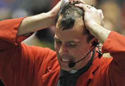 Trader Steven Rickard reacts in the S&P 500 futures pit at the CME Group in Chicago near the close of trading, Thursday, May 6, 2010. The stock market had one its most turbulent days ever with the Dow Jones industrials plunging nearly 1,000 points in half an hour before recovering two-thirds of its losses.