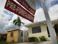 In Miami: JPMorgan has suspended some 56,000 foreclosures in 23 states because of possible legal flaws.