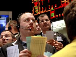 Traders at the Chicago Board of Trade monitor the numbers during the course of the trading day.