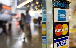 The lawsuit says the card companies are impeding merchants from promoting the use of competing credit or charge cards with lower acceptance fees.