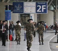 Soldiers patrol at Charles de Gaulle airport near Paris on Monday.