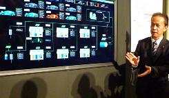 Toyota Motor's Shigeki Tomoyama explains about the Toyota Smart Center in Tokyo.