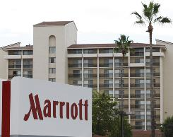 Marriott International returned to a profit in the third quarter as revenue rose on higher room rates.