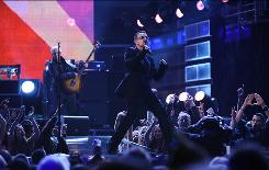 Lead singer Bono and U2 perform at the start of the 2009 Grammy Awards Show in Los Angeles.