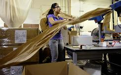 Liz Campos packs boxes at Lazy Susan in Los Angeles. She would prefer a full-time job at the home decor business, with benefits.