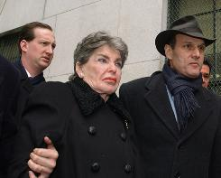 Leona Helmsley is escorted from State Supreme Court by her attorneys Jeffrey Taub, left, and Steven Eckhaus, right, on Jan. 28, 2003, in New York. Helmsley testified in her own defense against a $40 million wrongful termination lawsuit. Helmsley served more than a year in prison after her 1989 tax evasion conviction.