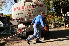 Mike Walsh makes a heating oil delivery in Arlington, Mass.