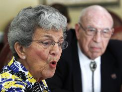 Stella Wehrly, left, speaks as her husband Hank looks on during an interview at the St. Andrews Estates North retirement community in Boca Raton, Fla.